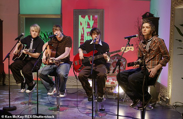 Back together: Earlier this month, the McFly members delighted fans when they confirmed they would be releasing new music for the first time in a decade (pictured in 2004)