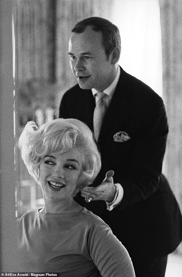 In 1958 he got a call from Marilyn Monroe. Their first meeting at her East 57th Street apartment — where Kenneth was struck by the star's natural beauty when she appeared in just a bathrobe — was the start of a close working relationship, and a firm friendship. Pictured:Marilyn and Kenneth Battelle in 1961