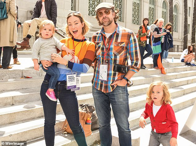 Happy family: Wilde, 36, and Sudeikis, 45, began dating in November of 2011, later getting engaged in January of 2013, and they share son Otis, six, and daughter Daisy, four (pictured in March, 2018)