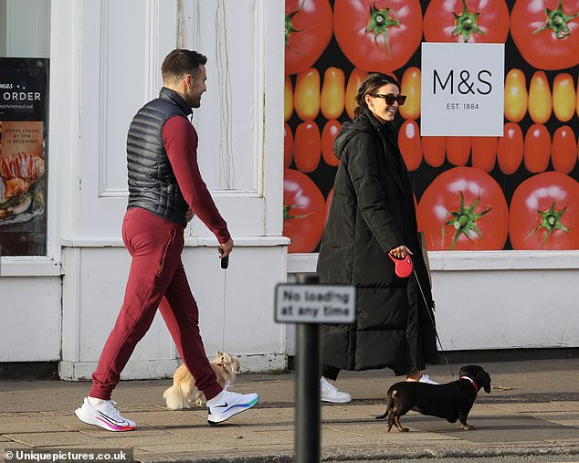 Happy: The pair flashed a smile as they enjoyed a spot of fresh air while England remains in lockdown