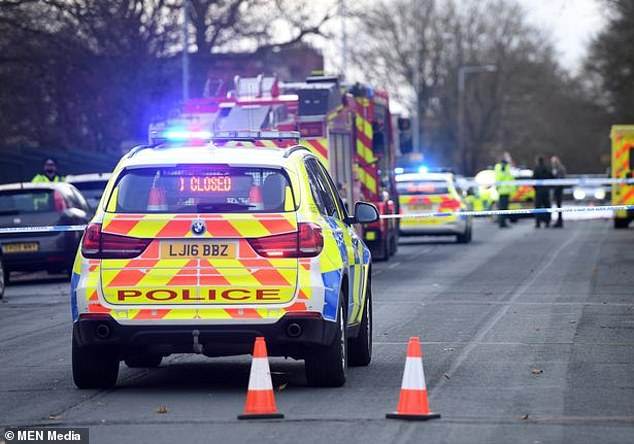 A 23-year-old man has been arrested and charged with causing death by dangerous driving and is due in Wigan and Leigh Magistrates court tomorrow. Pictured: The scene of the tragedy