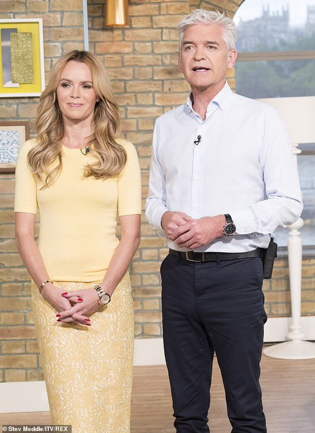 Far from pals: Reports have long been rife about troubles between the pair, and Amanda said she believed Phil sabotaged her chances of filling in on This Morning in 2018 (pictured in 2015)