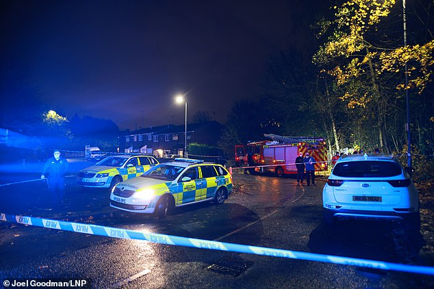The woman's cause of death has not been confirmed by police (pictured at the scene last night)