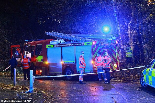Police arrived at the scene in Moston, Manchester, at 6:15 following reports of a fire and tragically discovered the woman dead. Pictured: A fire engine at the scene
