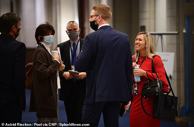 Greene, far right, with RepublicanRepresentative-elect Byron Donalds on Friday. The House requires mask use in most situations, while the Senate has instituted no requirements for face coverings