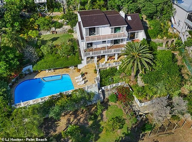 Sprawling: Once owned by the late Dame Joan Sutherland, the 1950s home (pictured) currently boasts a tennis court, outdoor pool and clifftop views of the ocean