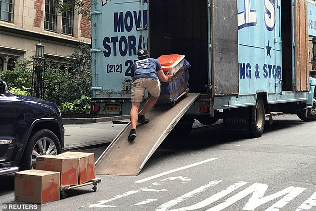 A report found that 44 per cent of New Yorkers earning $100,000 or more annually have considered moving from the city over the past several months. Pictured: A mover puts belongings into a moving truck following the outbreak of the coronavirus disease (COVID-19) in the Manhattan borough of New York City