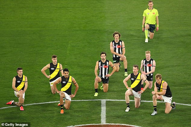 Richmond and Collingwood AFL players, along with the umpires took a knee prior to the bounce of their game which resumed the season after a 10-week layoff