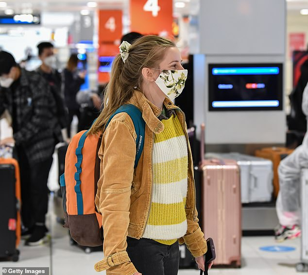 A passengers is pictured in Sydney Airport's baggage hall on August 5. Airlines estimate about  100,000 Australians are stranded overseas during the pandemic