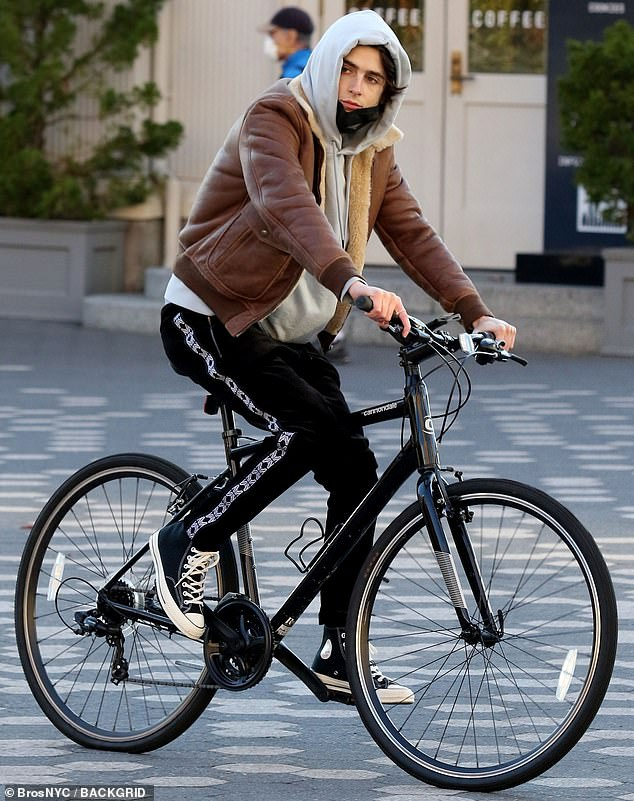 East coast vibes: Timothée Chalamet served east coast vibes Saturday in a brown leather bomber jacket, as he enjoyed a brisk autumn bike ride through downtown Manhattan and up the east side of the borough
