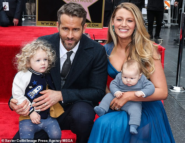 Proud dad: Ryan Reynolds recently admitted he 'never in a million years would've imagined' being a father to three girls, as he gushed about wife Blake Lively and their daughters to Access Hollywood (pictured in December, 2016)