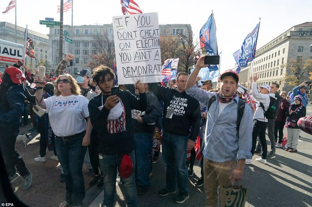 Trump supporters demonstrate as the motorcade carrying U.S. President Donald J. Trump drives by the rally