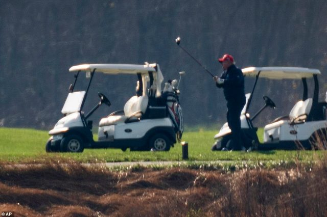 President Donald Trump played golf at Trump National Golf Club in Sterling, Virginia as his supporters rallied in DC