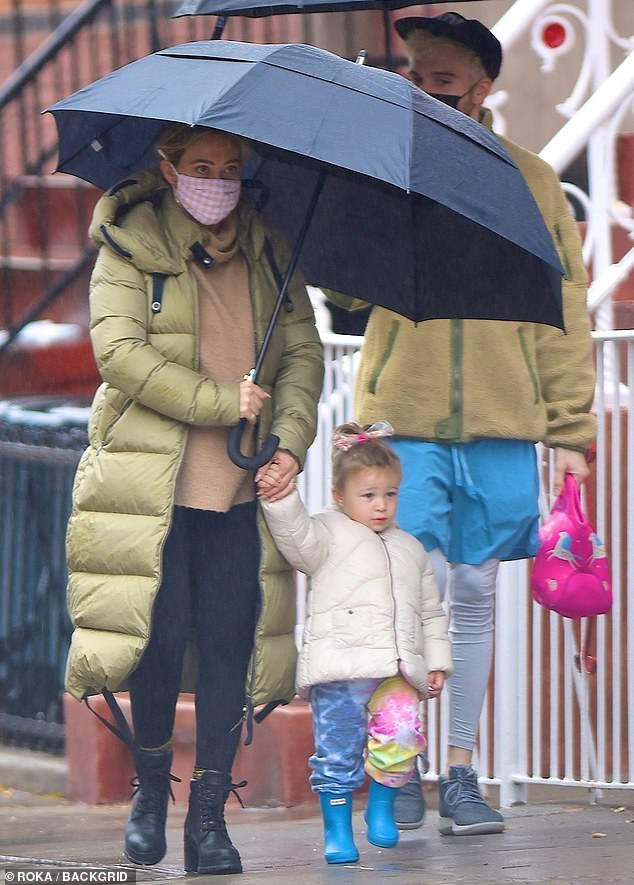 Layered look: Hilary Duffbundled up in layers Friday, as she grabbed some breakfast with husband Matthew Koma and daughter Banks, during a rainy family outing in Brooklyn