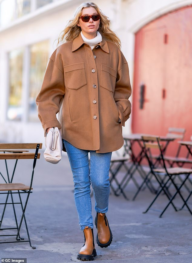 Mover and shaker:Elsa Hosk concealed her baby bump beneath an oversized flowing brown jacket while legging it out in Manhattan