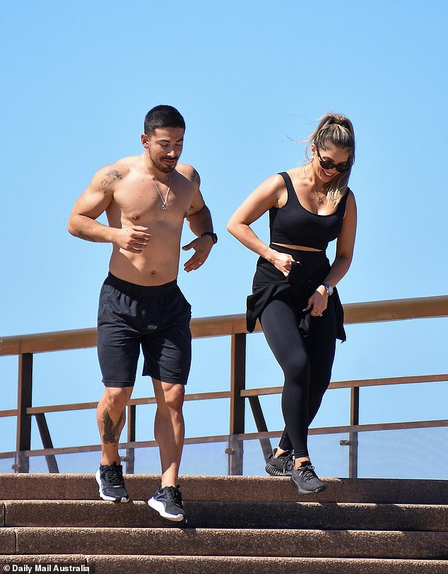 Fit: The 29-year-old fitness expert flaunted his chiseled abs as he endured a workout on the stairs of the iconic landmark alongside his wife