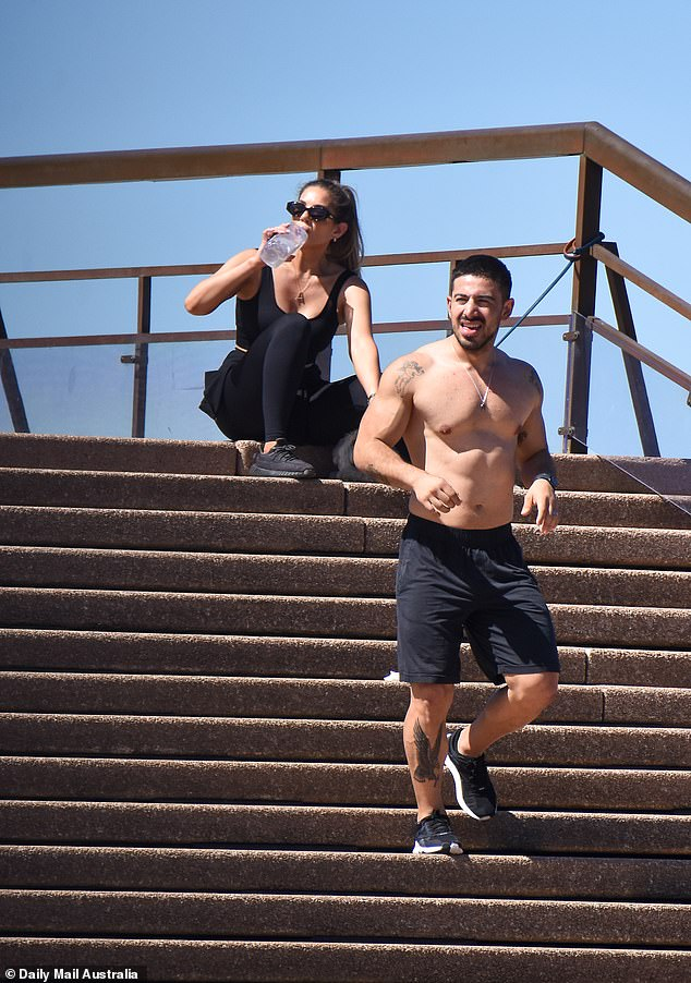 Looking good! Jono appeared to be making the most of Sydney's soaring temperatures and went shirtless for the workout