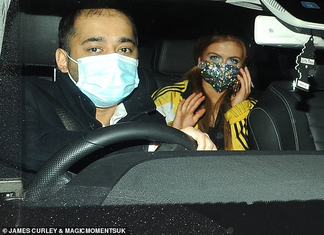 Splash of colour: Maisie, 19, was seen wearing a mustard yellow Adidas jacket and a sequin face mask as she jumped in her taxi and exited the venue