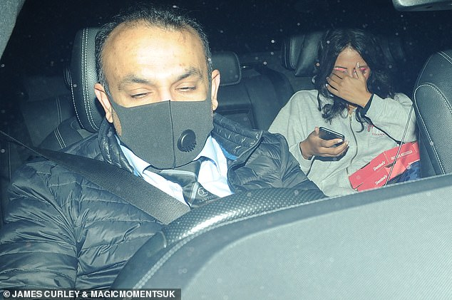 Keep a low profile: Ranvir Singh covered her face as she sat in the back of her vehicle