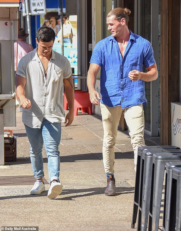 Laidback:Shannon, 30, got the casual memo, donning a white button-up shirt, slim-fit blue jeans and pristine white sneakers