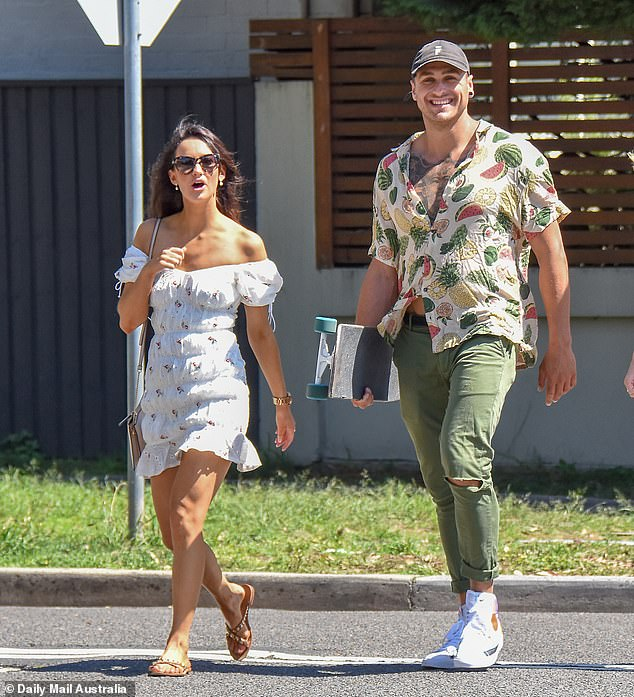 Glam: Emma, who starred on Matt Agnew's season of The Bachelor, revealed her trim figure in a white off-the-shoulder frock which she teamed with tan sandals and a shoulder bag