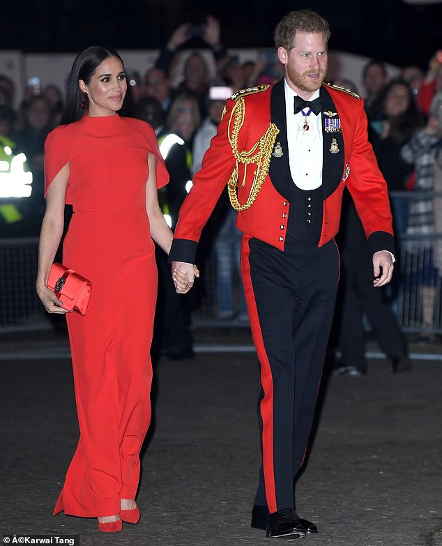 The appointment was seen as 'deeply significant' within the Royal Marines who this year saw Prince Harry (right with wife Meghan Markle on one of their final UK engagements at the Mountbatten Festival of Music at the Royal Albert Hall in March) step down as captain general of their elite force