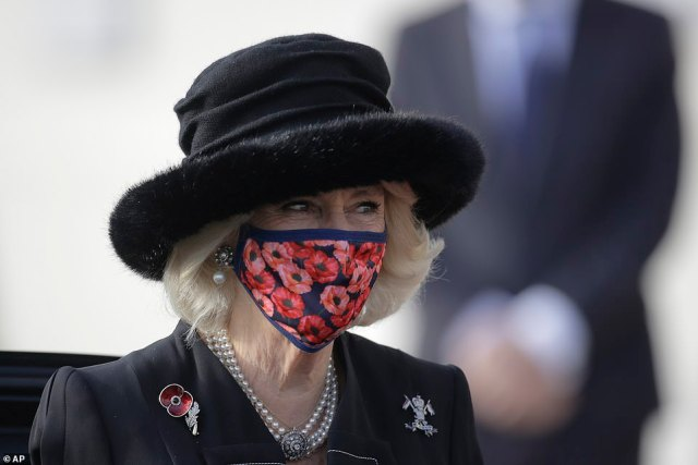 Camilla dressed all in black for the occasion and wore a face mask adorned in poppies as a tribute to the war dead