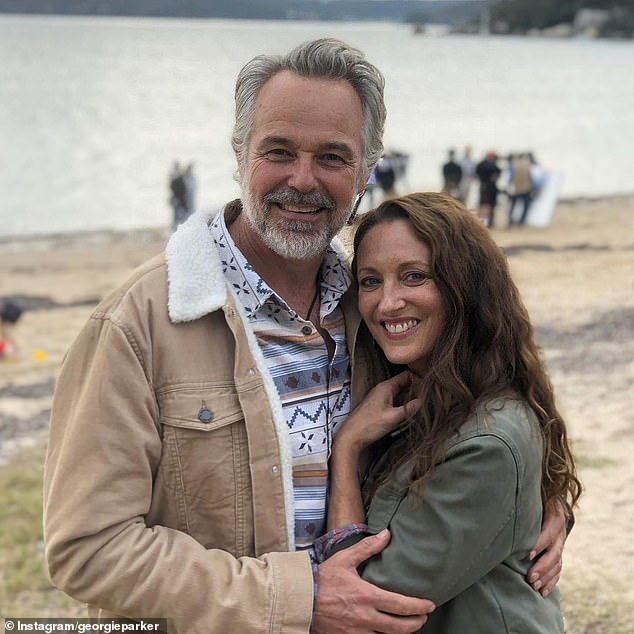 'Can't wait to work with you again!' On Friday, Georgie Parker and James Stewart delivered gushing tributes to Cameron Daddo as he left Home and Away. Pictured: Cameron and Georgie