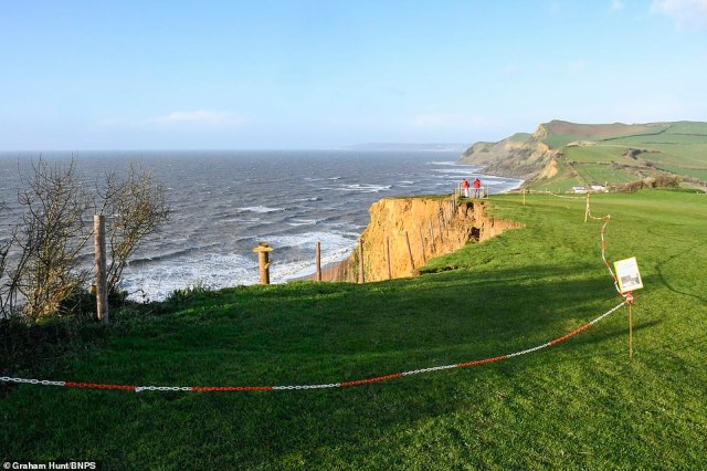 A large section of cliff at a Jurassic Coast beauty spot has collapsed overnight on the South West Coast Path next to Highlands End Caravan Park at Eype near Bridport in Dorset after heavy rain yesterday. This section of the coast path was closed and diverted at the beginning of November after large cracks appeared