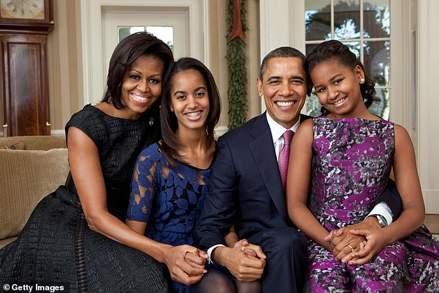 First Lady Michelle Obama, Malia Obama, U.S. President Barack Obama and Sasha Obama, sit for a family portrait in the Oval Office on December 11, 2011 in Washington, D.C.