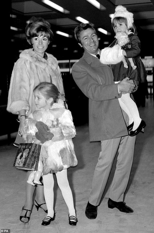 1968:Des O'Connor with his wife Gillian and children Tracy-Jane, 6, and Samantha, 4, as they left Heathrow Airport, London, to spend Christmas in Barbados