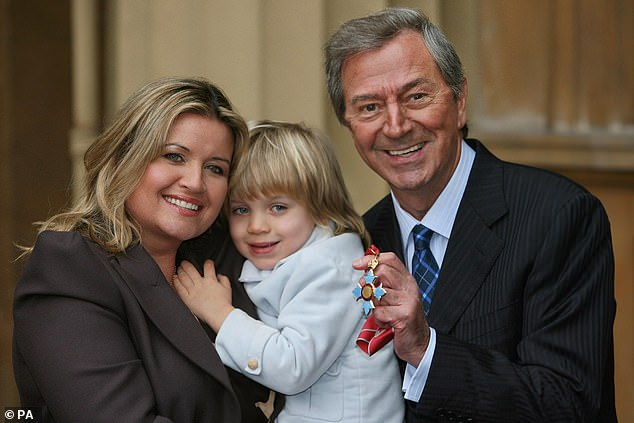 Des O'Connor posing with his CBE for services to entertainment and broadcasting, which was presented to him by Queen Elizabeth II at Buckingham Palace, London, with wife Jodie and four-year-old son Adam, 2008
