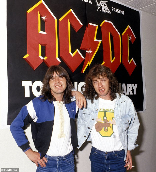 Three-year battle: Malcolm, who was the guitarist and co-founder of AC/DC, passed away at age 64 in November 2017 after a three-year battle with dementia. Malcolm is pictured on the left with Angus in 1988