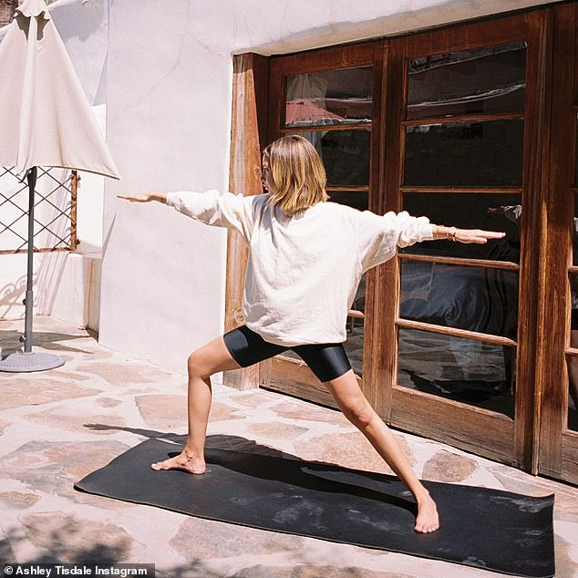 Good form: The 35-year-old actress sported a pair of short leggings and a sweatshirt as she sent salutations to the sun to start her day on the right foot