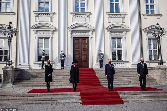 The foursome, all donning face masks, posed for a socially distanced picture outside the 18th century building which is the principal official residence of the Federal President of Germany