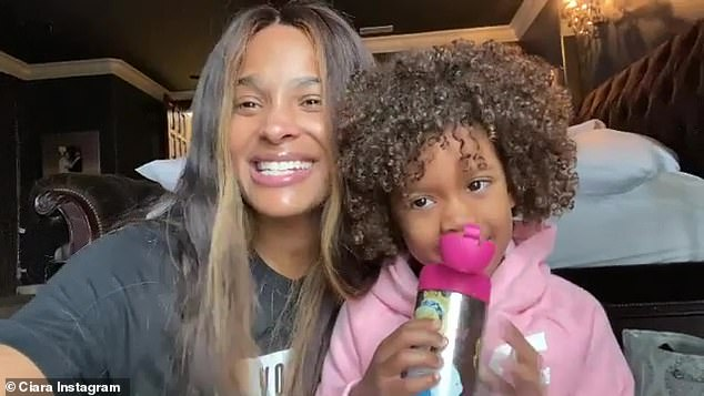 Go girls!: The Goodies hitmaker and her three-year-old daughter Sienna had a heartwarming response to the news that Biden-Harris were named as President and Vice President-elect; pictured November 7th