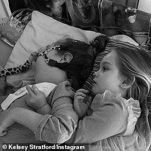 Siblings: Kelsey shared pictures of Kennedy using a ventilator to breathe while in bed with her sister