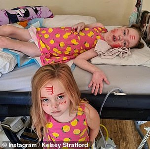 At home: One picture saw Kennedy playing with her sister
