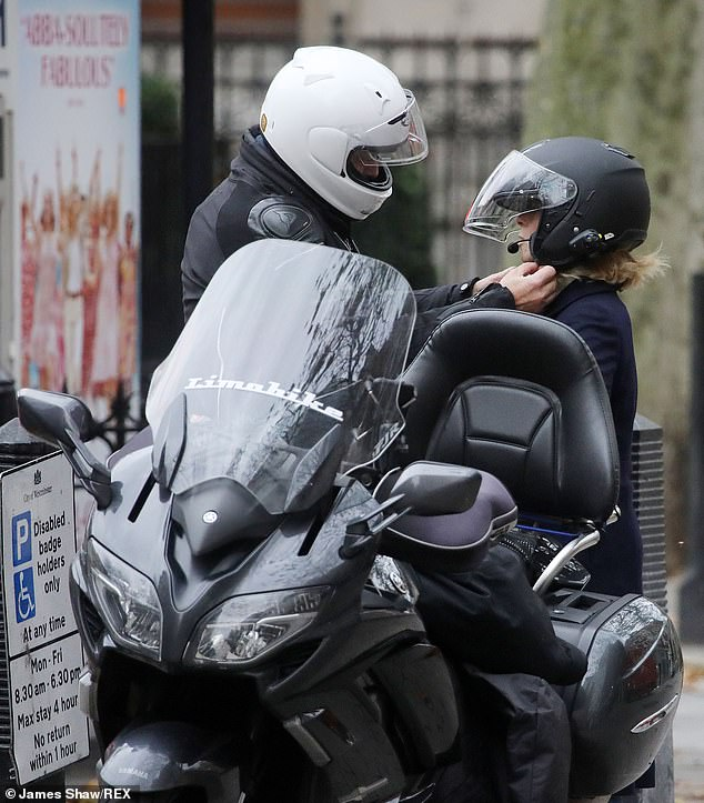 Off home:Kate was later seen leaving the studios after her show and hopping onto a motorbike taxi as she headed home