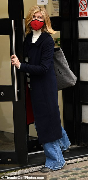 Stylish:The star carried a dove grey tote as she strolled in the capital and accessorised with a scarlet face mask
