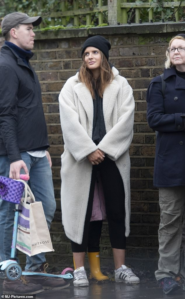 Look of love: Binky looked smitten with her beau as she chatted with him