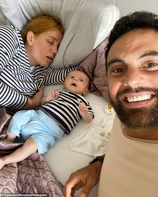 Missed the memo? New dad Cameron Merchant, 36, (right) has shared a sweet sleeping selfie of his wife Jules Robinson (left) and son Ollie wearing matching clothing