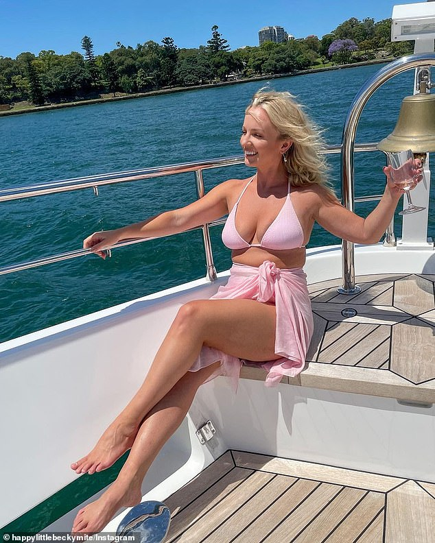 Pretty in pink: Becky Miles (pictured) was enjoying the trappings of her newfound fame this weekend as she partied with a bevy of beauties aboard a yacht for a Monday Swimwear event
