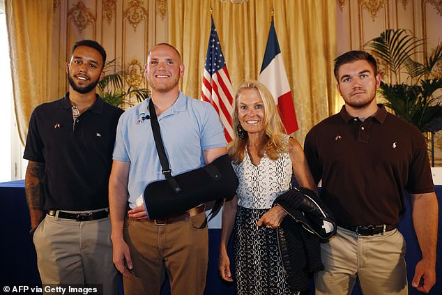 In this file photo taken on August 23, 2015 Off-duty US servicemen Anthony Sadler (left), Spencer Stone (second left), Alek Skarlatos (right) and US ambassador to France Jane Hartley (second right) pose after a press conference at the US embassy in Paris two days after the foiled attack