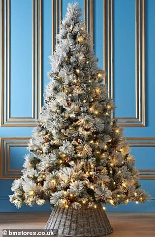 B&M is selling its artificial Christmas tree (pictured) for £160