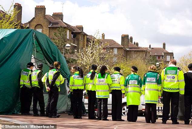 The charity usually provides first aid at more than 20,000 events each year. Pictured:First aiders line up for a briefing during the London Marathon in 2012