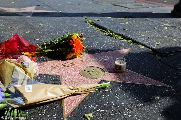 Beloved: Fans left flowers on Alex Trebek's star on the Hollywood Walk of Fame after his death
