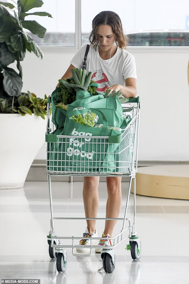 Veggie nice: She added to her off-duty look with a pair of colourful laced trainers and relied on her naturally striking features by going make-up free