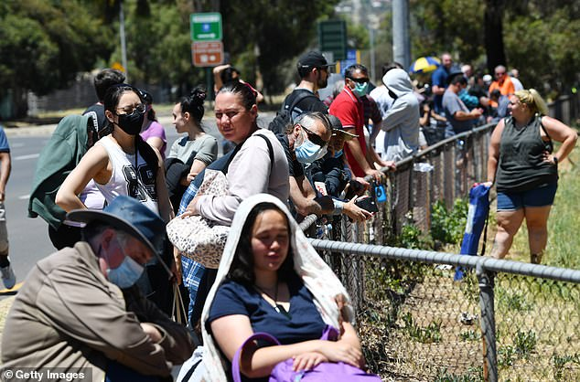 Residents are seen waiting for a coronavirus test in Adelaide on Tuesday, following an outbreak in the northern suburbs
