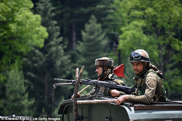 Indian army soldiers sit in military vehicle after June violence, worst border fighting with China in 53 years